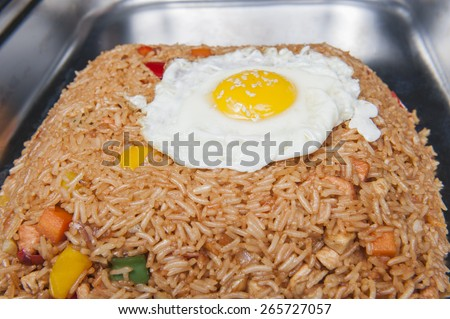 Closeup of Indonesian Nasi Goreng meal on display at a chinese restaurant buffet - stock photo