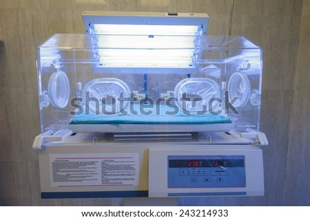 Closeup of infant incubator technology in a medical center hospital - stock photo