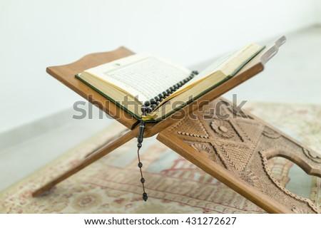 Closeup of Islamic Book Holy Quran   - stock photo
