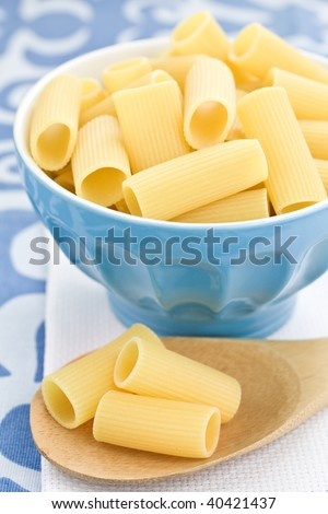 Closeup of italian pasta in a blue bowl - stock photo