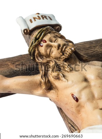 closeup of jesus crucified on the cross. image shows the face of jesus, part of the cross and the sign INRI - stock photo