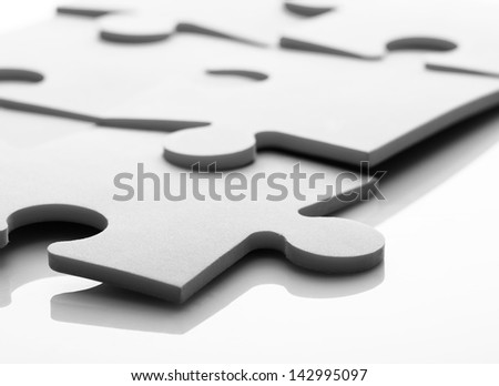 Closeup of jigsaw puzzle pieces - stock photo
