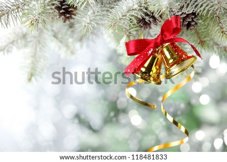 Closeup of Jingle bell from snowy tree. - stock photo