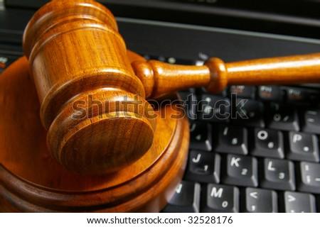 closeup of judges gavel on laptop computer - stock photo