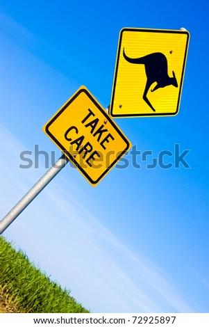 Closeup of kangaroo road warning sign against a blue sky - stock photo