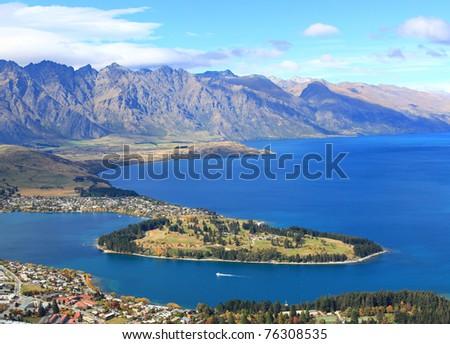 closeup of lake Wakatipu and Queenstown golf course garden island, New Zealand - stock photo