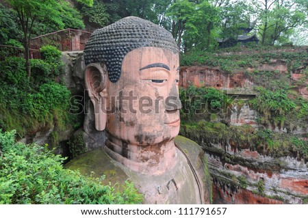 Closeup of largest buddha statue in the world in Leshan - China - stock photo