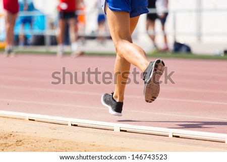 Closeup of legs of a track runner - stock photo