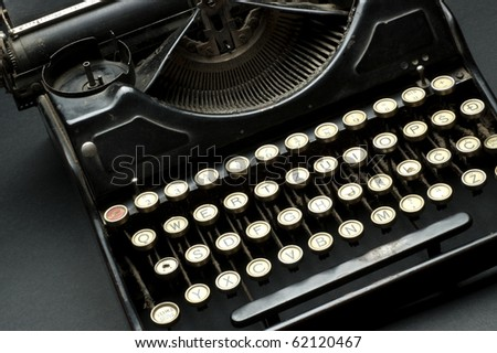 Closeup of letter and signs on old typewriter - stock photo