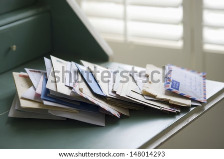 Closeup of letters on writing desk at home - stock photo