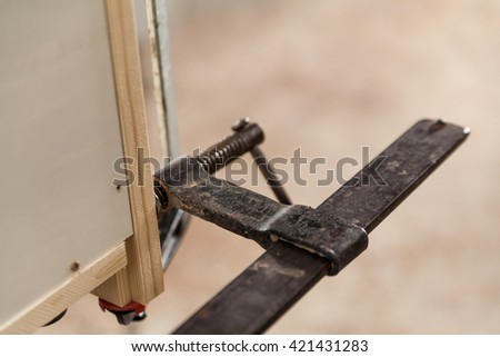 closeup of locking clamps detail on joinery workshop - stock photo