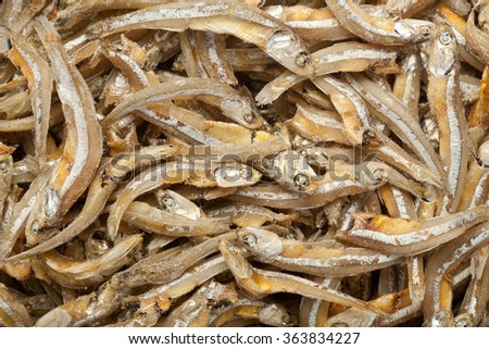 Closeup of lots of dried anchovies - stock photo