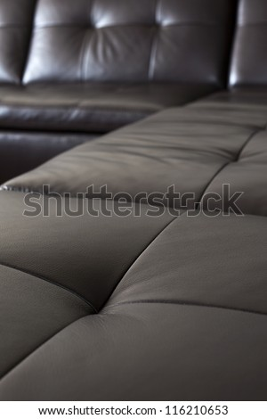 Closeup of luxurious expensive black leather couch - stock photo
