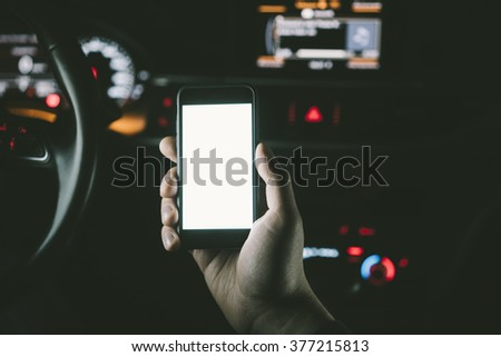 Closeup of male hand holding smart phone with blank screen for your text message or content - stock photo