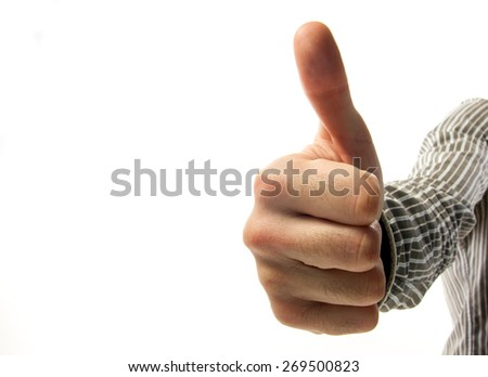 Closeup of male hand showing thumbs up sign against white background. Making like, recommend, success, social media like gesture with thumbs up. Content marketing satisfaction concept. Copy space. - stock photo