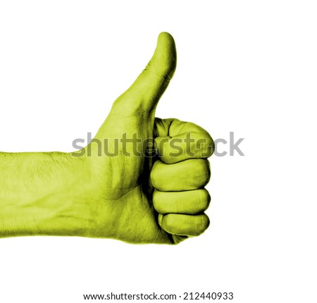 Closeup of male hand showing thumbs up sign against white background, yellow skin - stock photo