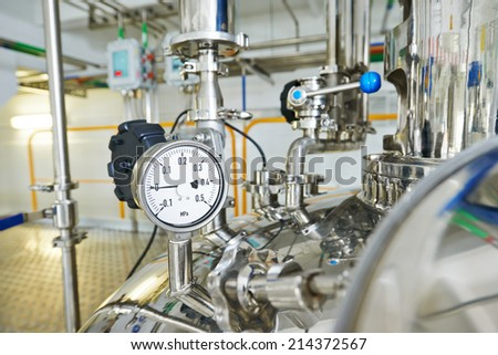 Closeup of manometer, pipes and faucet valves of heating system in a boiler room - stock photo