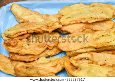 Closeup of many crisp yellow sliced plantain banana fry, fried in pan with hot coconut oil Kerala India. Traditional snacks of South India and traditional Desserts food in Thailand - stock photo
