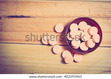 Closeup of medical capsule or pill or drug. A lot of colorful medication and pills. - Vintage tone. - stock photo