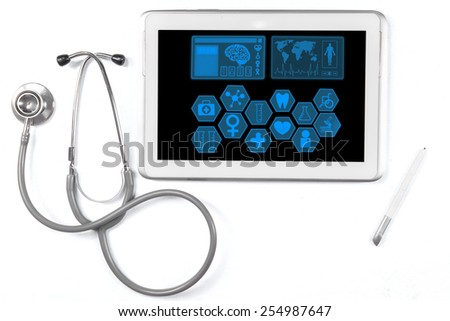 Closeup of medical tablet showing medical symbols on the screen with stethoscope - stock photo