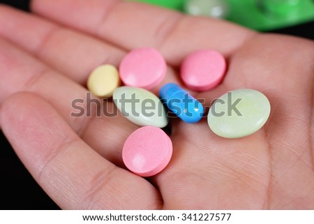 Closeup of medication. Medications in the palm of your hand. The patient, a doctor. Prescription drugs. Supplements, antibiotics. Tablets on the palm - stock photo