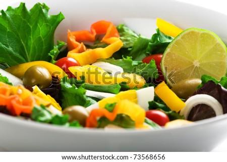 Closeup of Mediterranean salad with fresh vegetables - stock photo