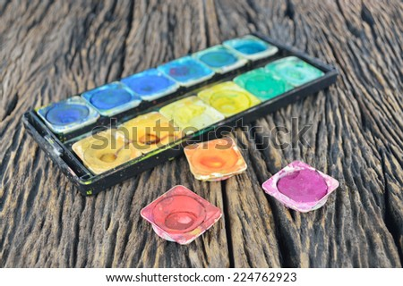 Closeup of messy, used water color paint box - stock photo