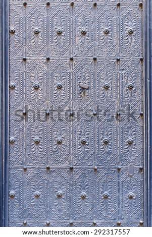 Closeup of metal violet color vintage door  - stock photo