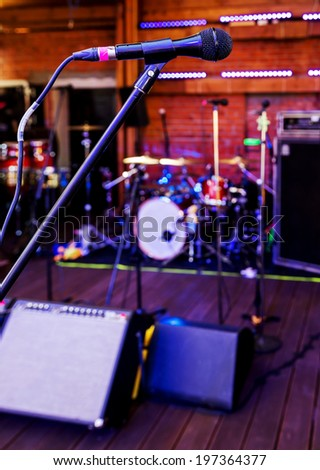 Closeup of microphone in the concert hall of nightclub - stock photo