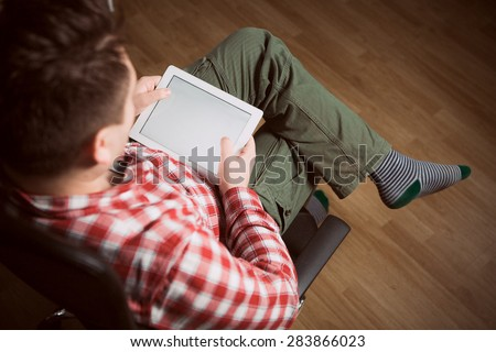 Closeup of mid adult man  looking at blank screen of digital tablet at home - stock photo