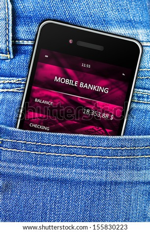 closeup of mobile phone in jeans trousers pocket - stock photo