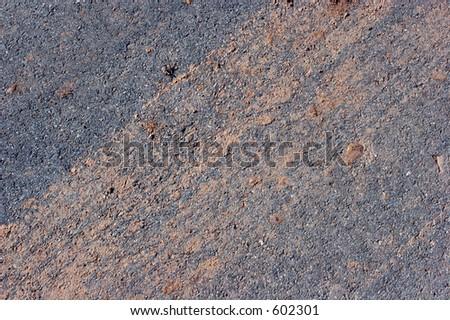 CLoseup of mud on asphalt surface. - stock photo