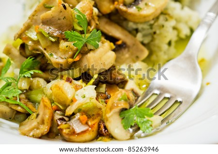 closeup of mushrooms with risotto - stock photo