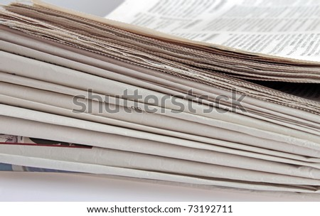 closeup of newspaper stack - stock photo