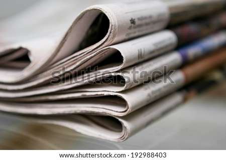 Closeup of newspapers - stock photo