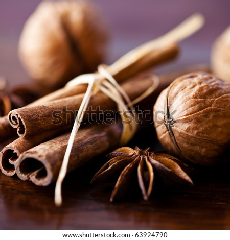 Closeup of nuts and aromatic spices for christmas cake - stock photo