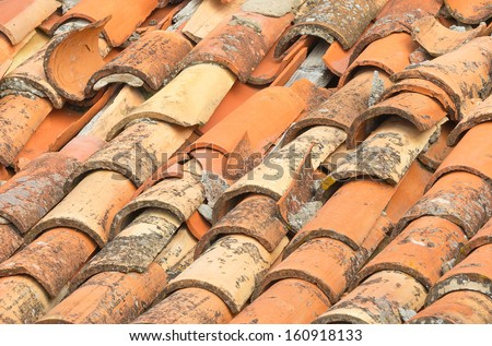 Closeup of old and damaged roof tiles in Dubrovnik - stock photo