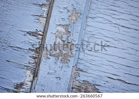 Closeup of old door with blue peeling paint - stock photo