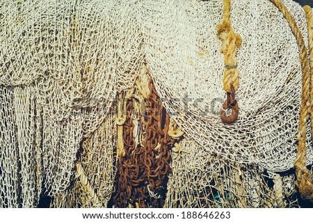 Closeup of old fishing nets - stock photo