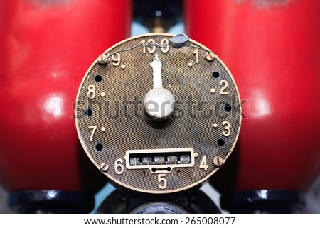 Closeup of old fuel pump dial with arrow - stock photo