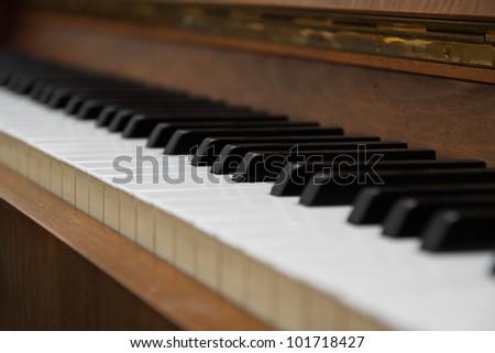 Closeup of old piano keyboard. - stock photo