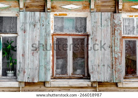 Closeup of old rural slum  house windows in Astrakhan, Russia - stock photo