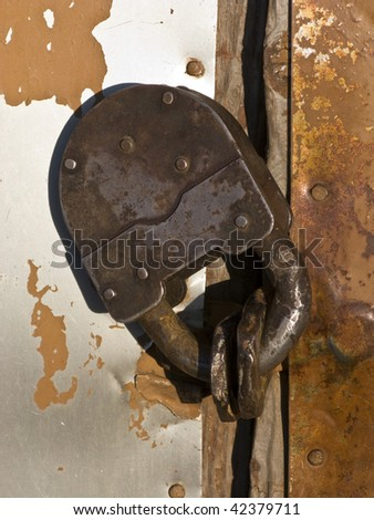 Closeup of old rusty padlock - stock photo