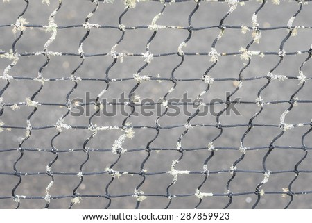 Closeup of old vintage tennis net background - stock photo