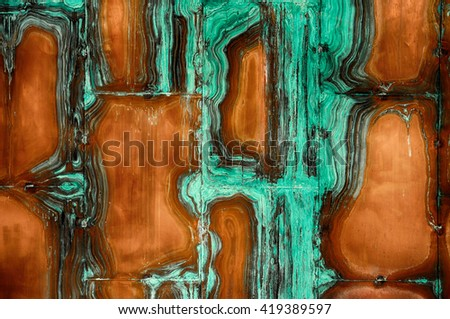 closeup of old worn cooper wall with green verdigris. - stock photo