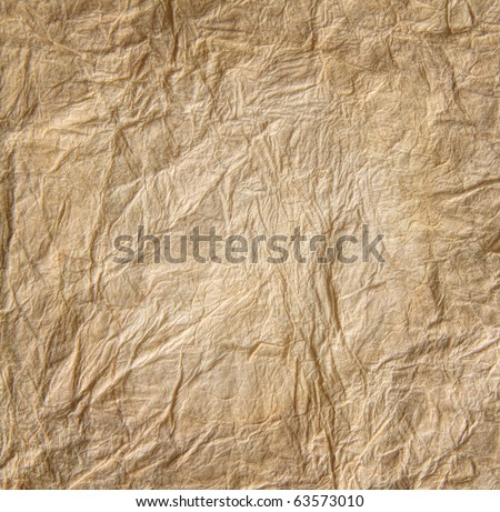 Closeup of old wrinkled parchment paper - stock photo