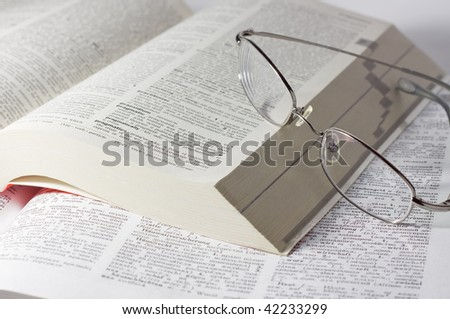 closeup of opened books with glasses - stock photo