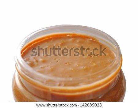 closeup of opened peanut butter jar - stock photo