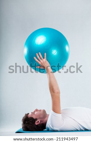Closeup of patient exercising on floor exercise mat - stock photo