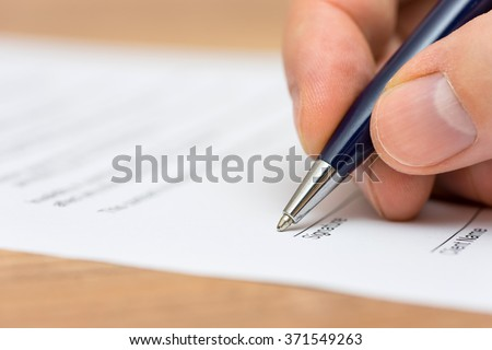 closeup of pen and human fingers  signing document - stock photo